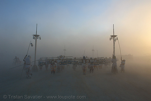 the lamplighters - burning-man 2006, art, burning man, lamplighters, light pole, march, petrol lanterns, poles, procession