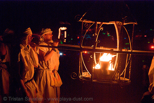 lamplighters carrying lantern - fire conclave - burning man 2007, burning man, fire conclave, flames, lamplighters, lantern, night of the burn