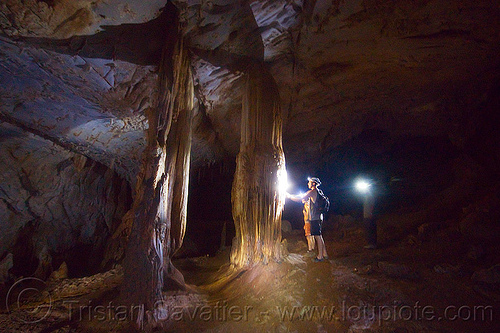 large cave formation columns - clearwater cave - mulu (borneo), cave formations, cavers, caving, clearwater cave system, clearwater connection, columns, concretions, gunung mulu national park, natural cave, people, speleothems, spelunkers, spelunking