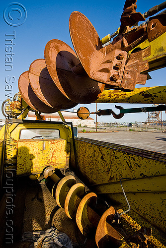 large ground drills on utility truck, drills, ground drill, junkyard, lorry, muni, no trespassing, san francisco municipal railway, utility truck, yellow