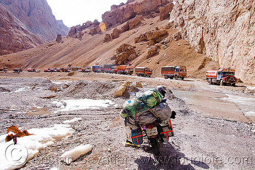large nullah in the canyon before pang - manali to leh road (india), 500cc, canyon, gorge, ladakh, motorbike touring, motorcycle touring, mountains, nullah, pang, river bed, road, royal enfield bullet, stream, traffic jam, trucks, valley, water