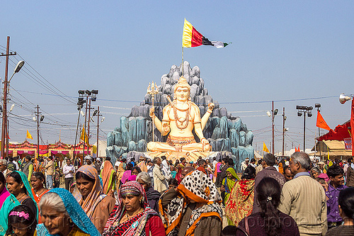 large statue of lord shiva at kumbh mela (india), ashram, crowd, flags, hindu ceremony, hindu pilgrimage, hinduism, india, maha kumbh mela, sculpture, shiva, statue, walking