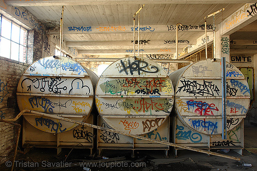 large water tanks in abandoned factory, abandoned factory, derelict, graffiti, industrial, street art, tags, three, tie's warehouse, trespassing, water tanks
