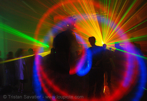 laser show - moving lights and shadows in warehouse underground rave party, backlight, glowing, laser lightshow, laser show, lasers, led lights, night, nightclub, nightlife, rave lights, ravers, silhouettes