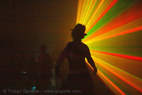 laser show - shadow in warehouse underground rave party, backlight, laser lightshow, laser show, lasers, nightclub, nightlife, rave lights, ravers, silhouettes