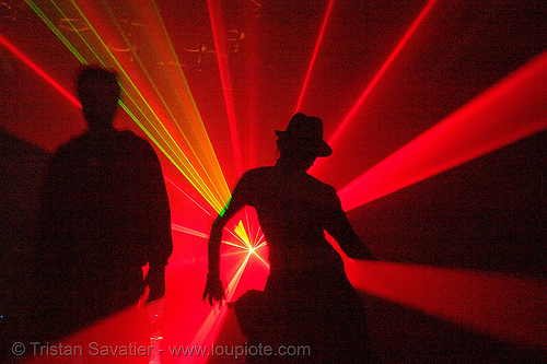 laser show - shadows dancing in warehouse underground rave party, backlight, laser lightshow, laser show, lasers, nightclub, nightlife, rave lights, ravers, red, silhouettes