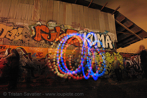 laura spinning oggz at tire beach (san francisco), glowing, graffiti, industrial, laura, led lights, light poi, long exposure, night, oggz, rave lights, spinning light, toxic beach, warehouse