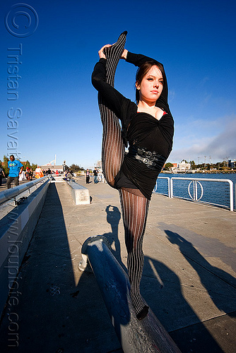 leg scale - stretching - natasha - superhero street fair (san francisco), contortionist, islais creek promenade, leg scale, natasha, stretching, superhero street fair, woman