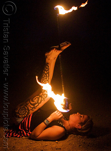 leg tattoo - lily spinning fire staff with feet (san francisco), fire dancer, fire dancing, fire performer, fire spinning, flames, long exposure, night, people, tattooed, tattoos, woman