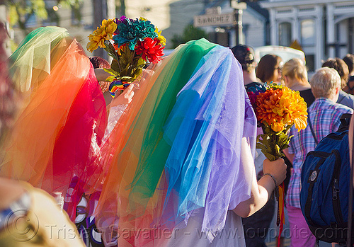 lesbian couple in rainbow color wedding dresses, bridal bouquets, brides, dolores park, gay couple, gay marriage, gay pride festival, gay wedding, lesbian couple, rainbow colors, same-sex marriage, same-sex wedding, veils, wedding bouquet, wedding dress, wedding dresses, women