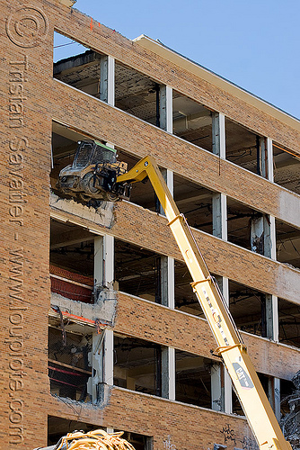 lifting CAT 226B skid steer loader with hydraulic boom - building demolition, abandoned building, abandoned hospital, at work, building demolition, cat 226b, caterpillar 226b, excavators, front loader, heavy equipment, hydraulic, machinery, presidio hospital, presidio landmark apartments, skid steer loader, working