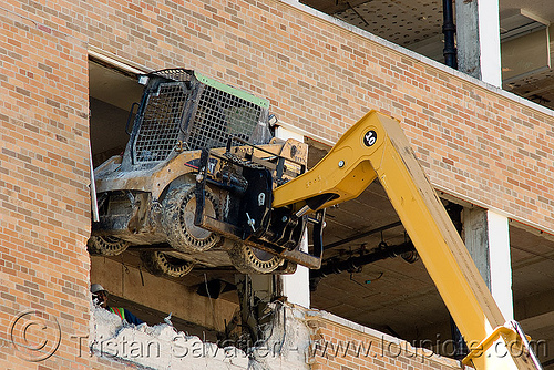 lifting caterpillar CAT 226B skid steer loader with hydraulic boom - building demolition, abandoned building, abandoned hospital, at work, attachment, building demolition, cat 226b, caterpillar 226b, excavators, front loader, heavy equipment, hydraulic, machinery, presidio hospital, presidio landmark apartments, skid steer loader, working