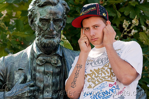 lincoln and cell phone, cellphone, festival, guy, love fest, lovevolution, man, people, sculpture, statue