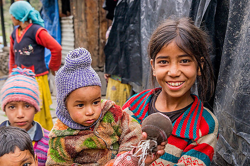 little girl holding baby in himalayan village (india), baby, children, india, janki chatti, kids, knit cap, little girl, toddler