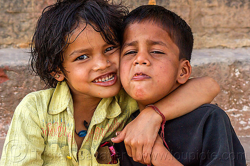 little girl hugging her brother, india