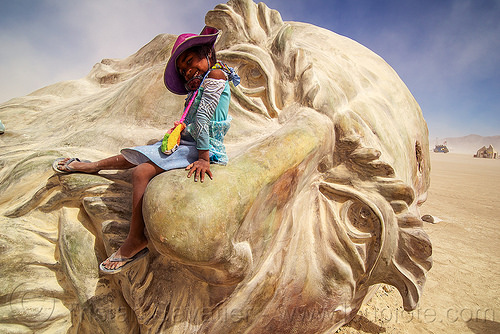 little girl on da vinci's nose - burning man 2016, art installation, burning man, child, da vinci head, giant head, kid, little girl, sculpture