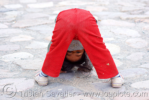 little girl playing (argentina), child, cobblestones, iruya, kid, legs, little girl, noroeste argentino, playing, quebrada de humahuaca, upside-down