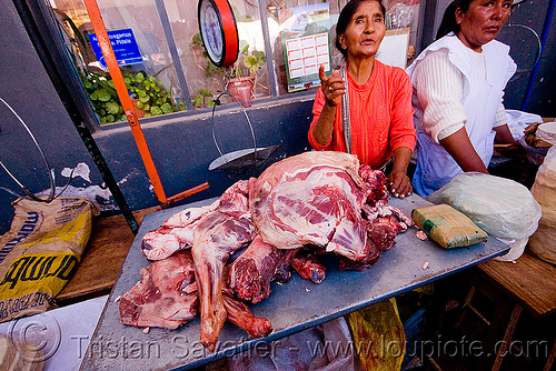 llama meat - street market (argentina), andean carnival, butcher, carnaval, humahuaca, meat market, meat shop, noroeste argentino, people, quebrada de humahuaca, raw, raw meat, street vendor, woman