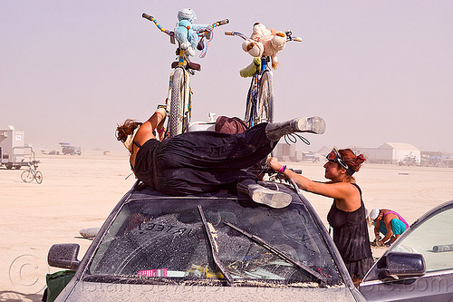 loading bicycles on roof rack, burning man, car, car roof, jilian, packing, people, sari, women