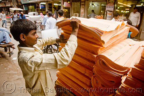 loading sheets of printed paper onto a cycle rickshaw (india), delhi, india, jayyed press, men, print shop, printed paper, printed sheets, printing shop, tibetan prayers, workers