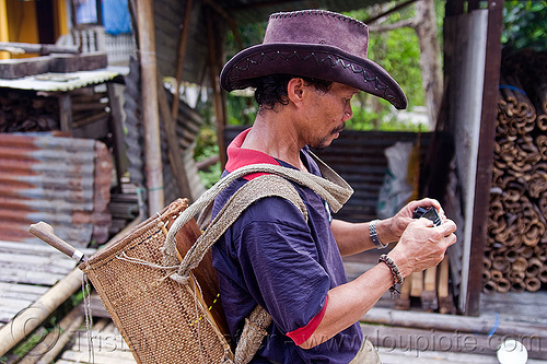 local guide - annah rais longhouse (borneo), annah rais, backpack, cellphone, leather hat, longhouse, man, village
