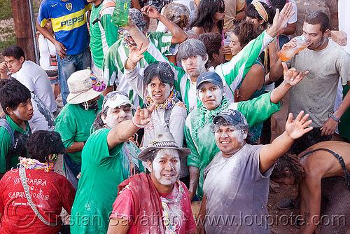 locals carnival partygoers covered with talk powder - carnaval de tilcara (argentina), andean carnival, carnaval, noroeste argentino, quebrada de humahuaca, talk powder, tilcara