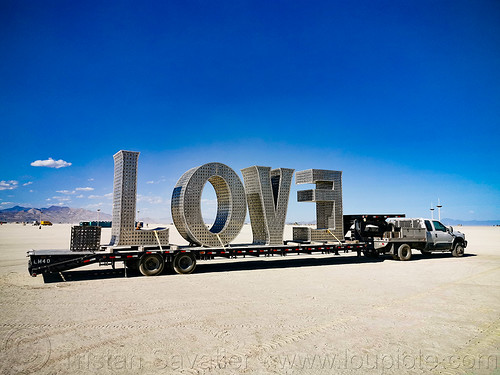 LOVE sculpture - giant letters - burning man 2019, big words, burning man, large words, letters, love, metal sculpture, trailer, truck, word