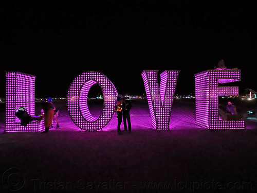 LOVE sculpture - giant letters - burning man 2019, big words, burning man, glowing, large words, letters, love, metal sculpture, night, pink, word