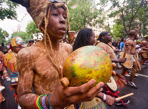 macara player - choukaj at the carnaval tropical de paris, caribbean, carnaval tropical, choukaj, costumes, creole, créole, guadeloupe, indigenous culture, macara, man, music player, parade, paris, percussion, percussionist, playing, shaking, traditional, tribal, west indies
