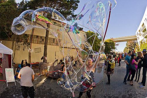 making giant soap bubbles with mesh of rope, giant soap bubble