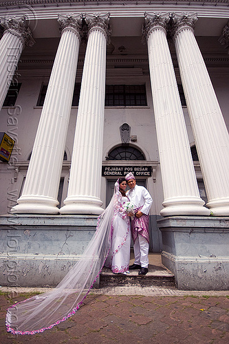malay wedding in front of the general post office (kuching), architecture, bridal bouquet, bride, columns, couple, groom, kuching, malay wedding, man, post office, traditional wedding, wedding dress, white flowers, white roses, woman