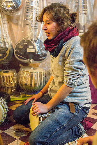 malou - girl playing djembe drum, india, varanasi