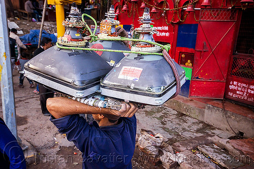 man carrying CRT screens on his head (india), bearer, carrying on the head, cathodic ray tubes, crt, delhi, electronics, man, porter, porting, recycling, rope, television, tv screens, wallah