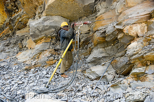 man drilling rock - drilling and blasting - near keylong - manali to leh road (india), compressed air drill, drilling and blasting, dynamite blasting, explosive, groundwork, man, road construction, roadworks, rock blasting, worker, working