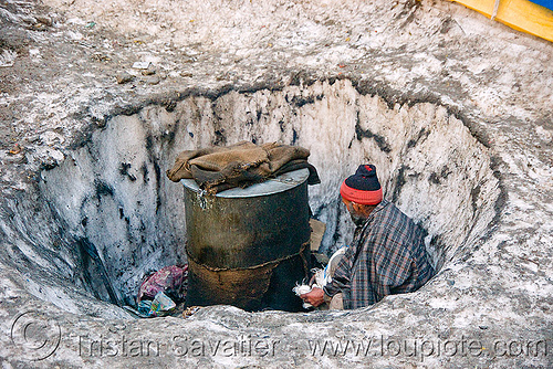 man heating water in a barrel - amarnath yatra (pilgrimage) - kashmir, amarnath yatra, barrel, hiking, hindu pilgrimage, hot water, india, kashmir, man, pilgrim, snow, trekking