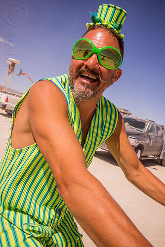 man in green stripe costume - burning man 2015, burning man, costume, green sunglasses, hat, stripes