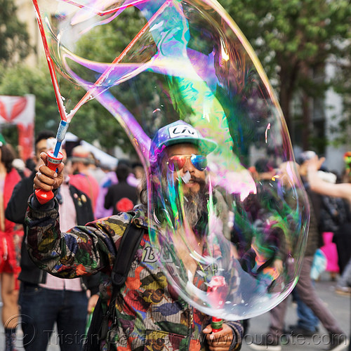 man making giant soap bubbles - how weird street faire (san francisco), giant soap bubble, how weird festival, iridescent, man