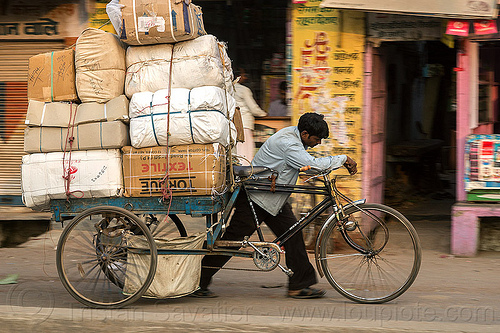 man pushing cargo tricycle with heavy load (india), bags, bearer, boxes, cargo tricycle, cargo trike, freight tricycle, freight trike, heavy, load, man, moving, pushing, sacks, street, transport, transportation, transporting, varanasi, walking