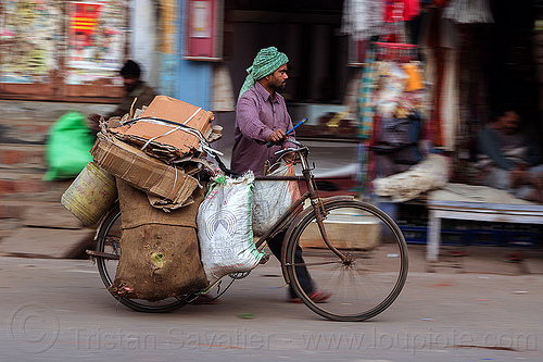 man pushing heavily loaded bicycle (india), bags, bearer, bicycle, bike, cargo, freight, headdress, heavy, india, load, man, moving, sacks, transport, transportation, transporting, turban, varanasi, walking