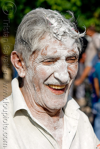 man's face covered with white talk powder - carnaval - carnival in jujuy capital (argentina), andean carnival, argentina, jujuy capital, man, noroeste argentino, san salvador de jujuy, talk powder, white