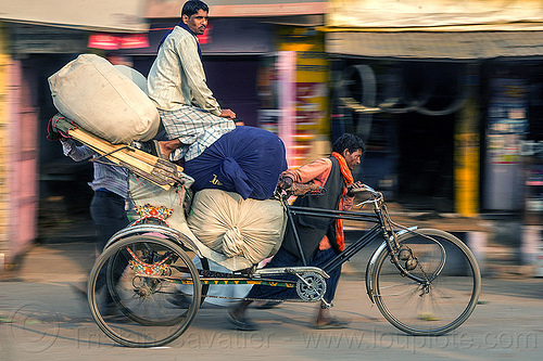 man sitting on top of large sacks on cycle rickshaw (india), bags, cargo, freight, heavy, load, men, moving, people, pushing, street, transport, transportation, transporting, varanasi, walking