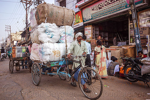 man walking cargo tricycle with heavy load of freight (india), bags, bearer, cargo tricycle, cargo trike, freight tricycle, freight trike, heavy, load, man, moving, pushing, sacks, street, transport, transportation, transporting, varanasi, walking