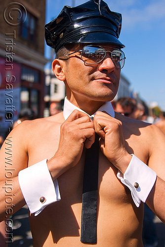 man wearing just cufflinks and a cap - up your alley fair, cufflinks, cuffs, leather cap, man, marcus, necktie, sunglasses