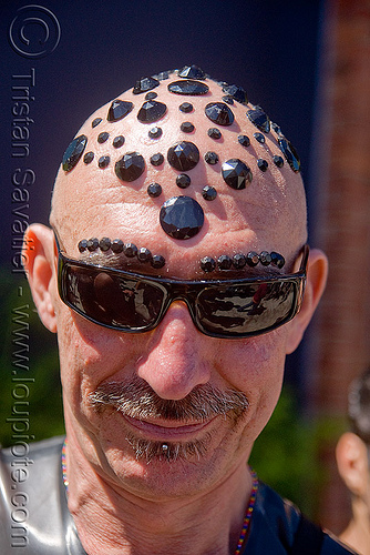 man with black bindis on head - up your alley fair, bald head, black bindis, jewelry, juan, man, scalp, shaved head, shaven head, sunglasses