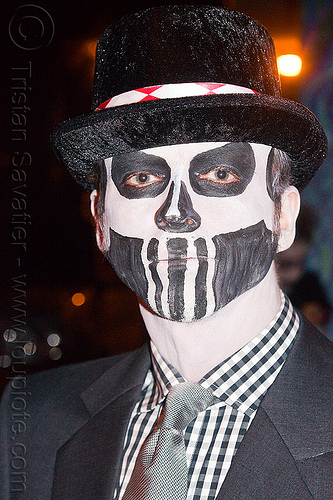man with black & white skull makeup, black hat, black suit, checkered shirt, day of the dead, face painting, facepaint, grey tie, halloween, man, night, sugar skull makeup