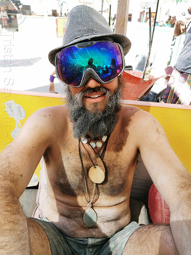 man with blue goggles at center camp - burning man 2019, bead, burning man, goggles, hat