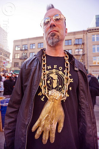 man with golden hand necklace - how weird 2012, golden chain, golden hand, how weird festival, man, necklace, people