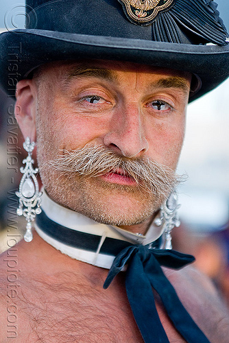 man with shirtless bow tie and earrings, bow tie, burning man, color contact lenses, contacts, costume, dickie bow, earrings, fashion show, mustache, randal smith, special effects contact lenses, stovepipe hat, theatrical contact lenses