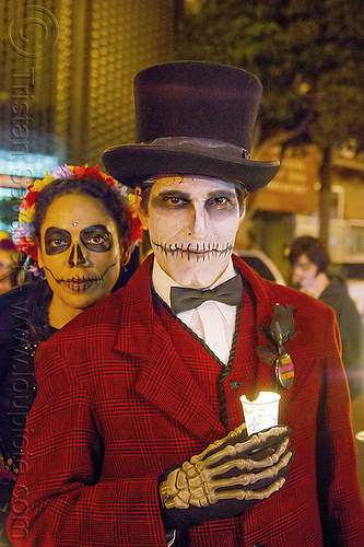 man with skull makeup and red costume - michael paim, bowtie, candle, couple, day of the dead, dia de los muertos, face painting, facepaint, halloween, hands, hat, man, michael paim, night, red color, sugar skull makeup, woman