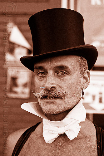 man with stovepipe hat and white collar - victorian fashion, bare chest, folsom street fair, man, moustaches, mustaches, nose piercing, sepia, septum piercing, stovepipe hat, victorian fashion, white collar